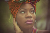 Matching beauty and style. African American woman in the park.