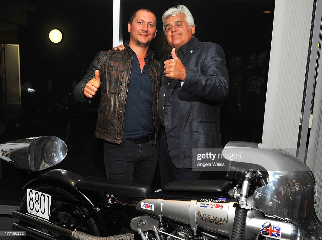 Matchless Motorcycles board member/director Michele Malenotti and comedian Jay Leno attend Return to the Salt with Brough Superior hosted by Jay Leno presented by Matchless and Ace Cafe at the The Petersen Automotive Museum on August 21, 2013 in Los Angeles, California.