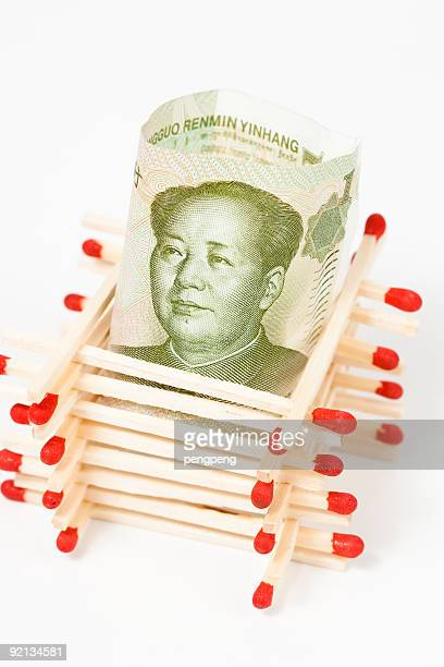 matchsticks and Chinese Yuan