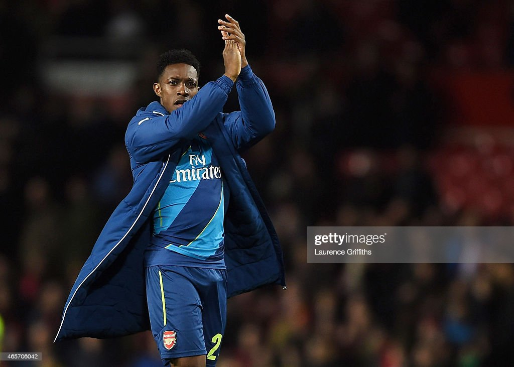Matchwinning goal scorer Danny Welbeck of Arsenal applauds the travelling fans following their team's 2-1 victory during the FA Cup Quarter Final match between Manchester United and Arsenal at Old Trafford on March 9, 2015 in Manchester, England.