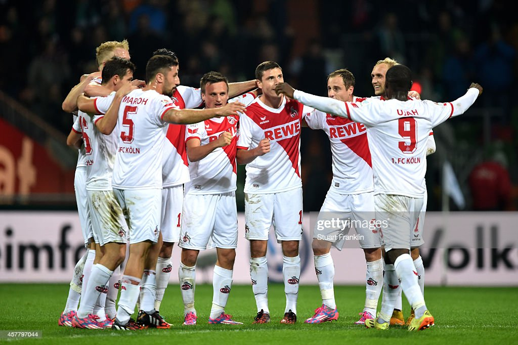 Matchwinning goalscorer Anthony Ujah #9 of Koeln celebates with teammates following their 1-0 victory during the Bundesliga match between SV Werder Bremen and FC Koeln at Weserstadion on October 24, 2014 in Bremen, Germany.