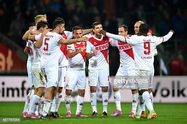 Matchwinning goalscorer Anthony Ujah of Koeln celebates with teammates following their 10 victory during the Bundesliga match between SV Werder...
