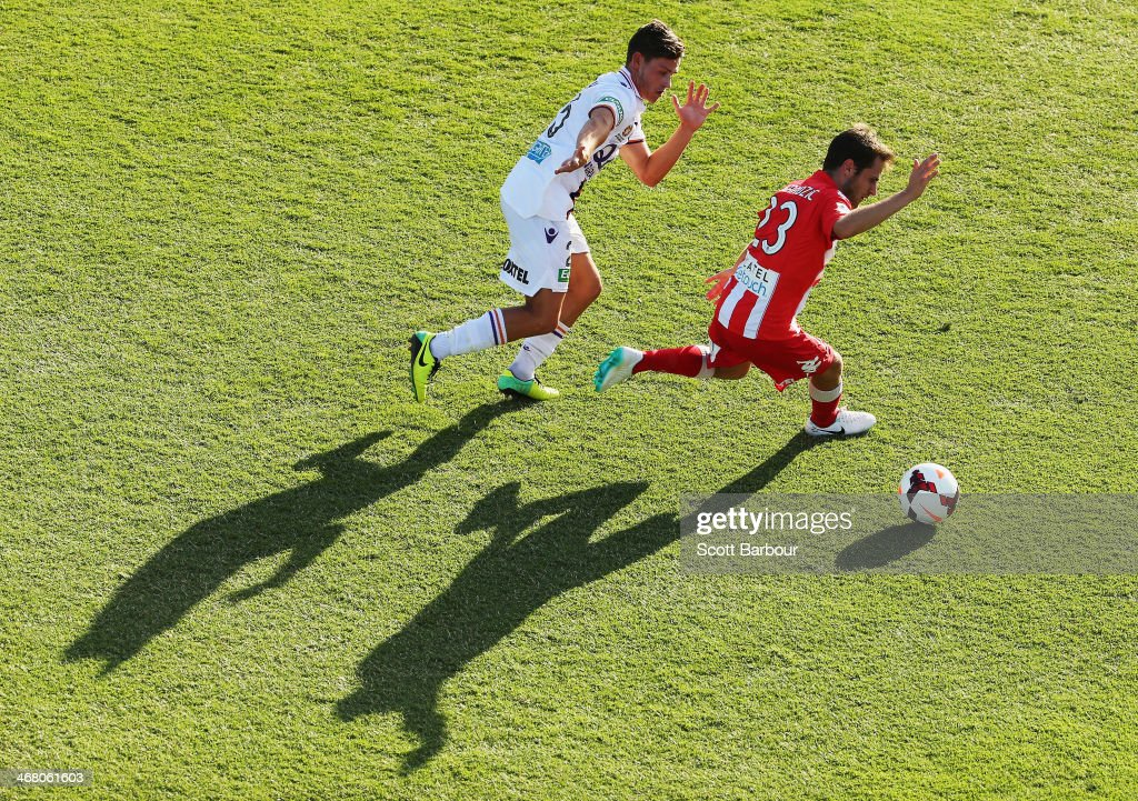 Mate Dugandic of the Heart and Riley Woodcock of the Glory compete the ball during the round 18 ALeague match between Melbourne Heart and Perth Glory...
