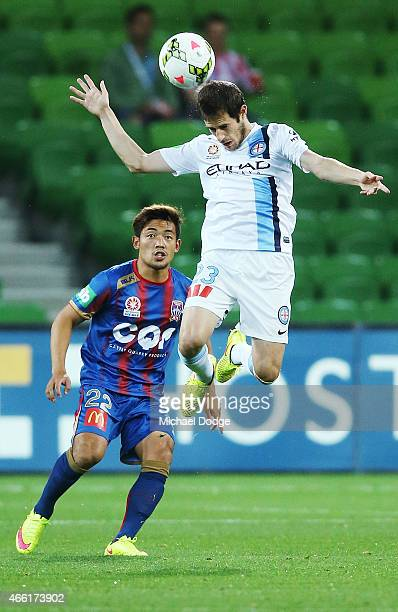 Mate Dugandzic of Melbourne City heads the ball from Kije Lee of the Jets during the round 21 ALeague match between Melbourne City FC and the...