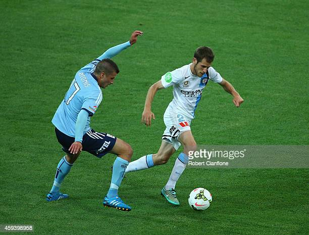 Mate Dugandzic of Melbourne City is challenged by Terry Antonis of Sydney FC during the round seven ALeague match between Melbourne City and Sydney...