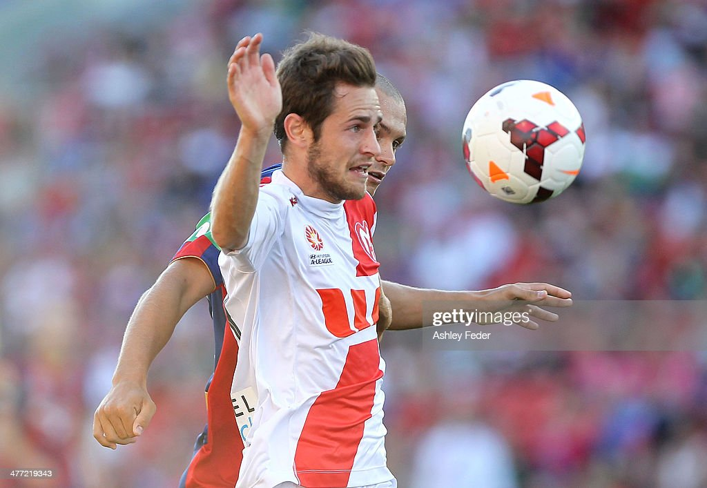 Mate Dugandzic of the Heart contests the ball against Jets defence during the round 22 A-League match between the Newcastle Jets and Melbourne Heart at Hunter Stadium on March 8, 2014 in Newcastle, Australia.