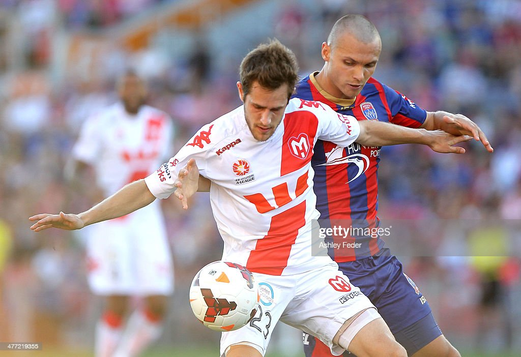 Mate Dugandzic of the Heart contests the ball against Samuel Gallaway of the Jets during the round 22 A-League match between the Newcastle Jets and Melbourne Heart at Hunter Stadium on March 8, 2014 in Newcastle, Australia.