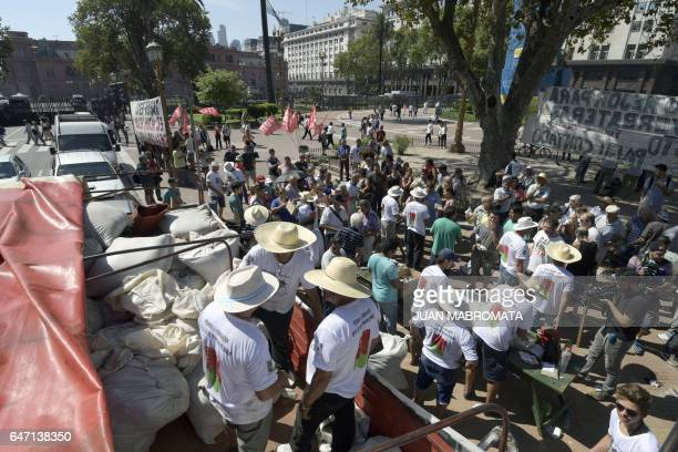 Mate growers from the province of Misiones northeastern Argentina unload from a truck sacks with packages of mate to be given for free at Plaza de...