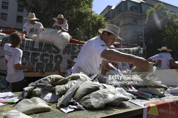 Mate growers from the province of Misiones northeastern Argentina give for free packages of mate at Plaza de Mayo square in Buenos Aires on March 2...