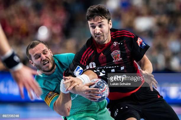 Mate Lekai of Veszprem is attacke by Viktor Tomas of Barcelona during the VELUX EHF FINAL4 3rd place match between Telekom Veszprem and FC Barcelona...