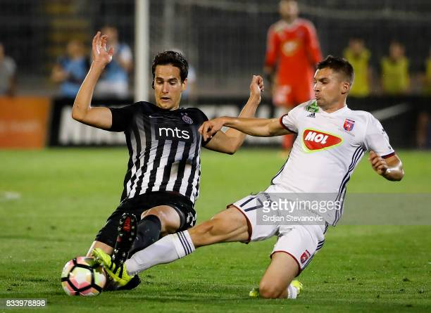 Mate Patkai of Videoton competes for the ball against Marko Jevtovic of Partizan during the UEFA Europa League Qualifying PlayOffs round first leg...