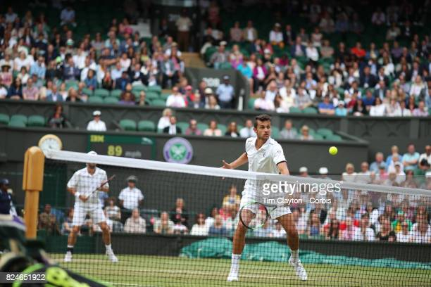 Mate Pavic of Croatian in action along with Oliver Marach of Austria in the Men's Doubles Final on Center Court during the Wimbledon Lawn Tennis...
