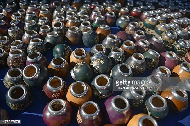 Mate traditional South American infusion cups are displayed for sale at a street market in San Telmo neighborhood Buenos Aires Argentina on June 14...