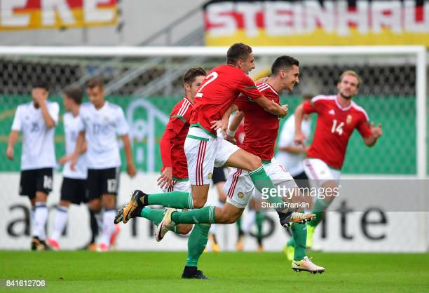Mate Vida of Hungary 21 celebrates scoring the second goal during the International friendly match between Germany U21 and Hungary U21 at the...
