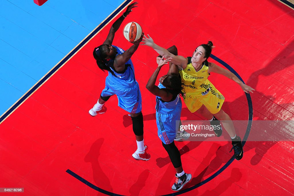 Matee Ajavon and Sancho Lyttle of the Atlanta Dream go for the rebound against Jenna O'Hea of the Seattle Storm during the game on July 5 2016 at...
