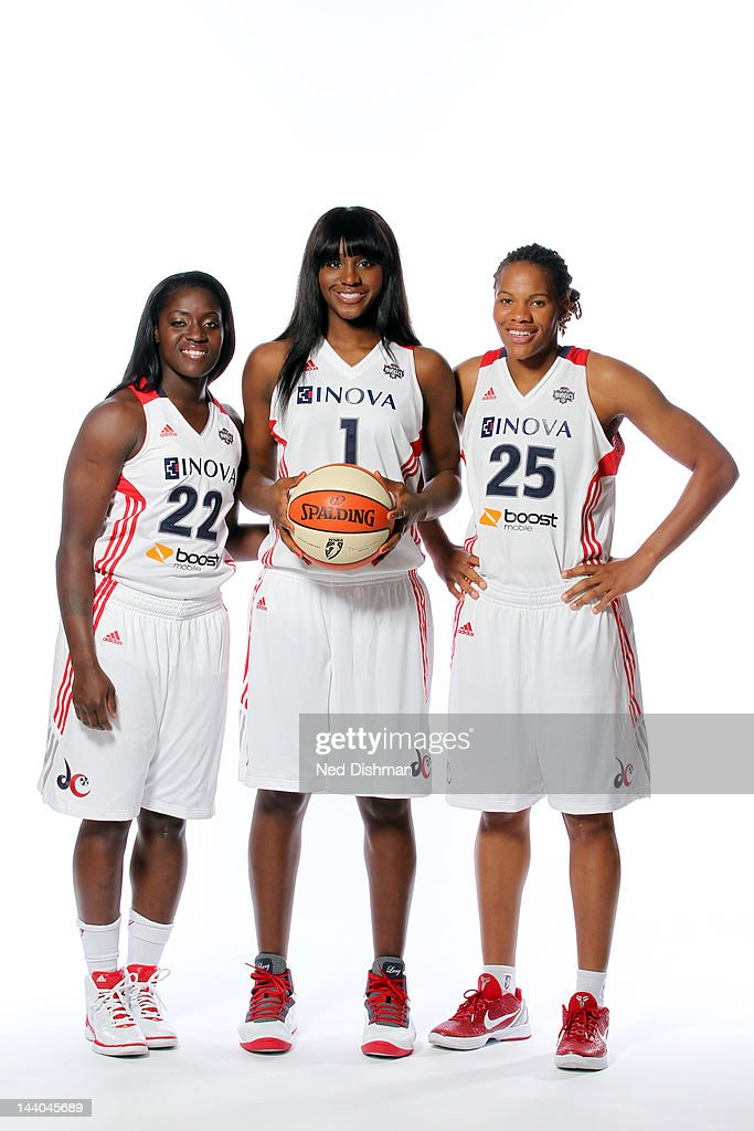 Matee Ajavon Crystal Langhorne and Monique Curry of the Washington Mystics pose for a photo during 2012 Washington Mystics media day on May 8 2012 in...