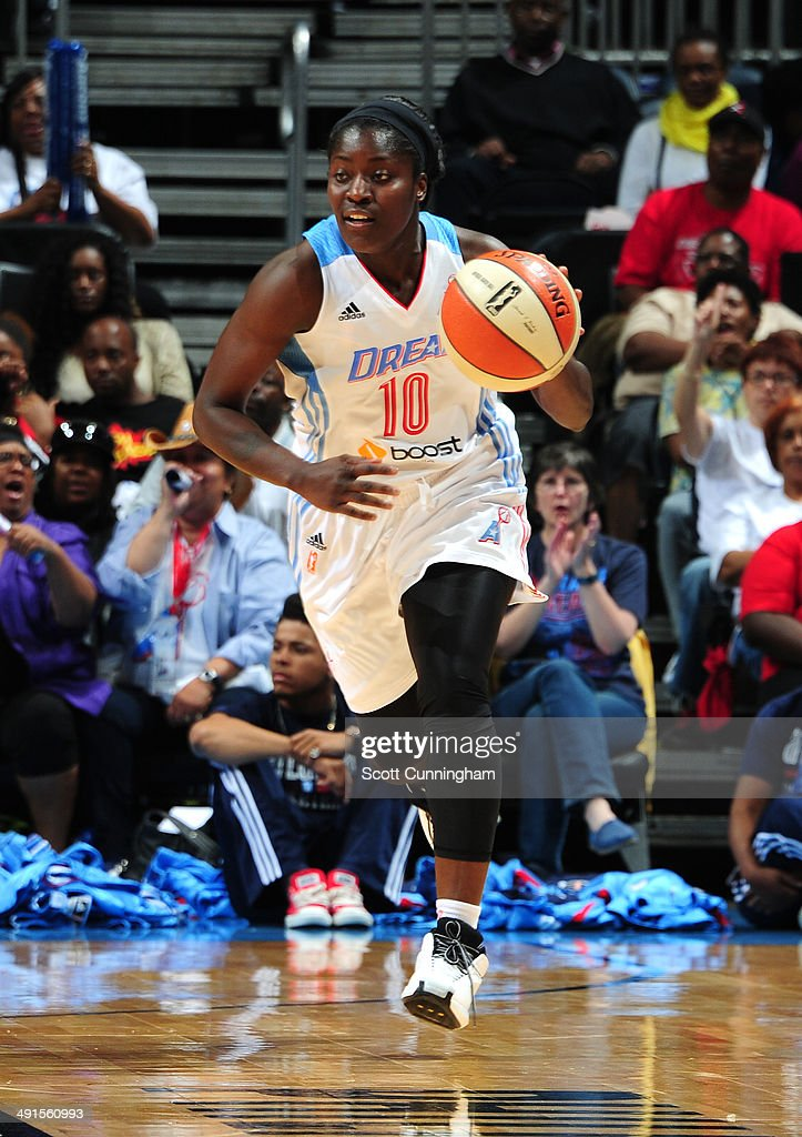 Matee Ajavon of the Atlanta Dream drives against the San Antonio Stars on May 16 2014 at Philips Arena in Atlanta Georgia NOTE TO USER User expressly...