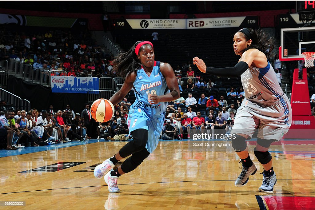 Matee Ajavon of the Atlanta Dream drives to the basket against Maya Moore of the Minnesota Lynx on June 10 2016 at Philips Arena in Atlanta Georgia...