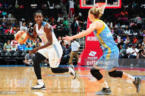 Matee Ajavon of the Atlanta Dream drives to the basket against Courtney Vandersloot of the Chicago Sky during the game at Philips Center on June 19...