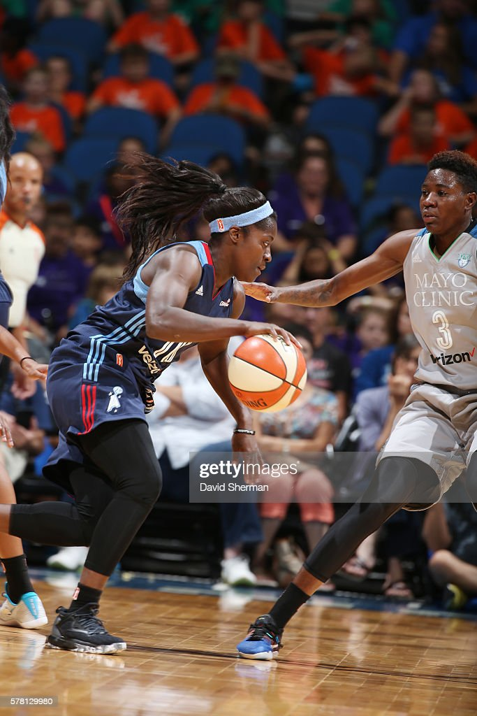 Matee Ajavon of the Atlanta Dream drives to the basket against Natasha Howard of the Minnesota Lynx on July 20 2016 at Target Center in Minneapolis...