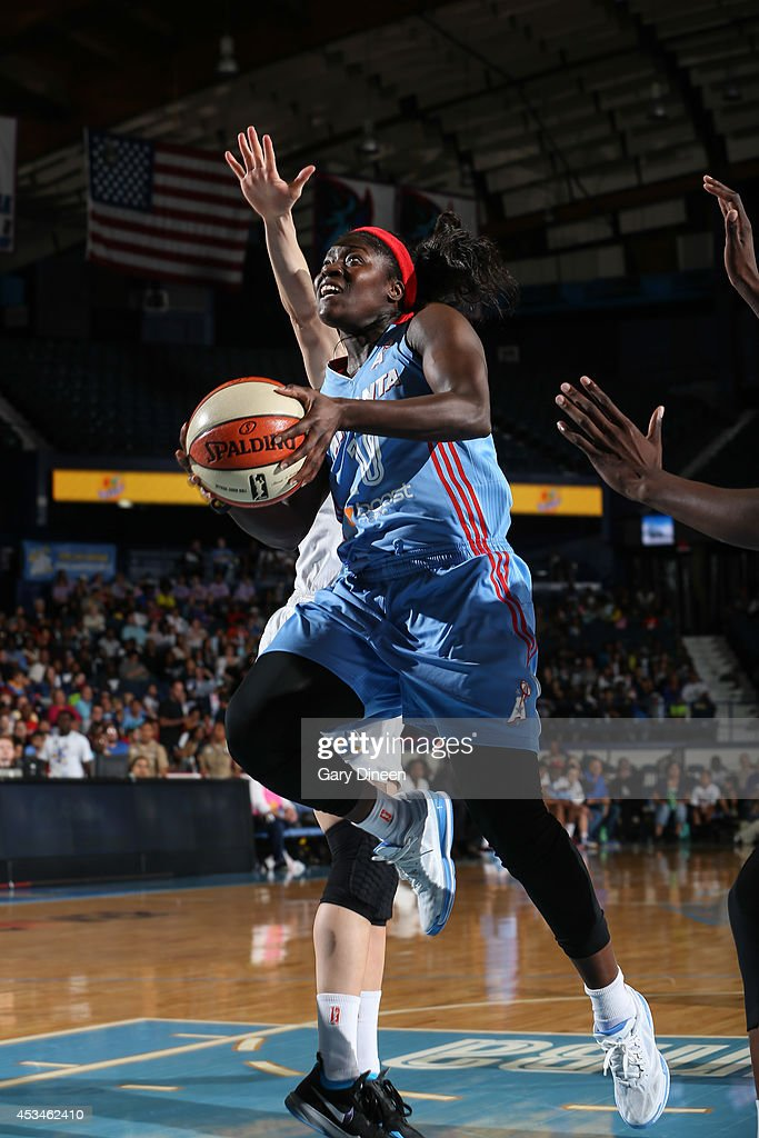 Matee Ajavon of the Atlanta Dream drives to the basket against the Chicago Sky on August 10 2014 at the Allstate Arena in Rosemont Illinois NOTE TO...