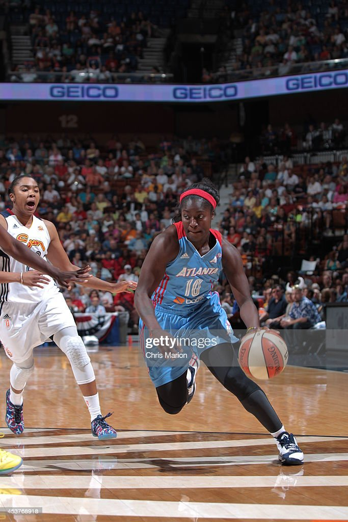 Matee Ajavon of the Atlanta Dream drives to the basket against the Connecticut Sun during a game at the Mohegan Sun Arena on August 17 2014 in...