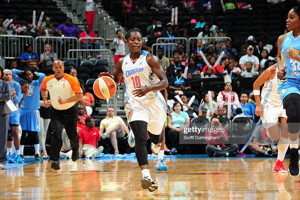 Matee Ajavon of the Atlanta Dream drives to the basket against the Chicago Sky during the game at Philips Center on June 19 2015 in Atlanta Georgia...