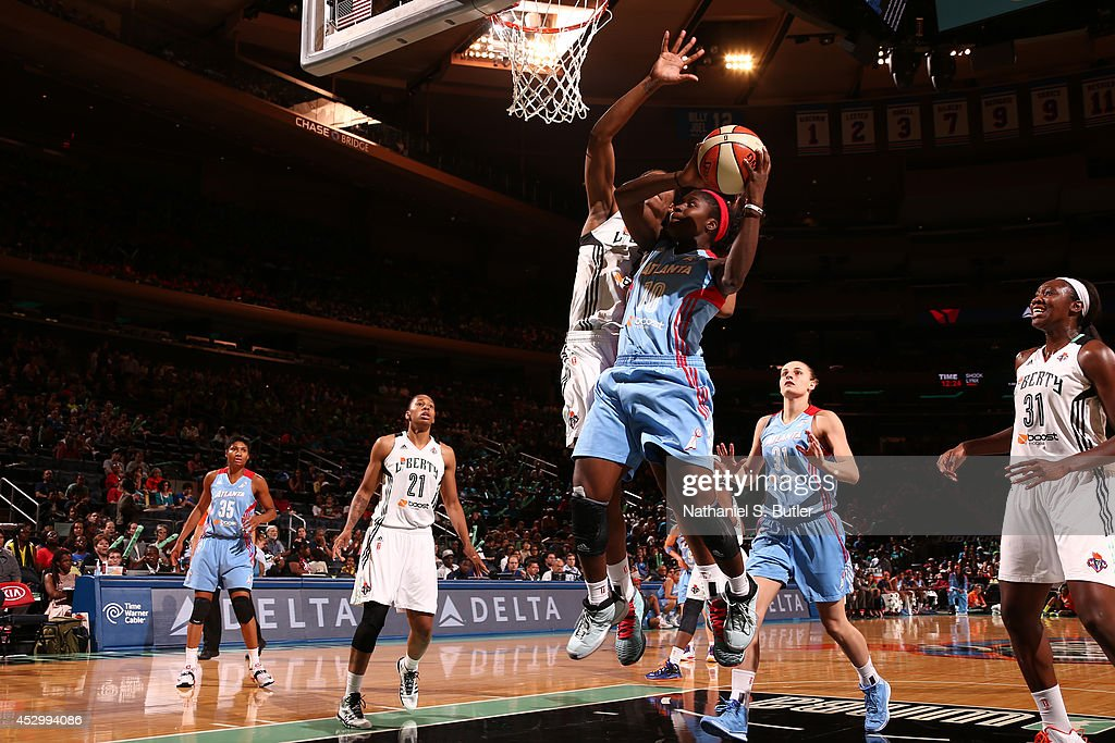 Matee Ajavon of the Atlanta Dream goes to the basket against the New York Liberty at Madison Square Garden in New York City on July 16 2014 NOTE TO...