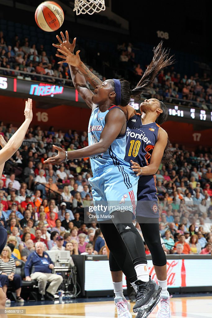 Matee Ajavon of the Atlanta Dream grabs the rebound Courtney Williams of the Connecticut Sun on July 10 2016 at Mohegan Sun Arena in Uncasville CT...
