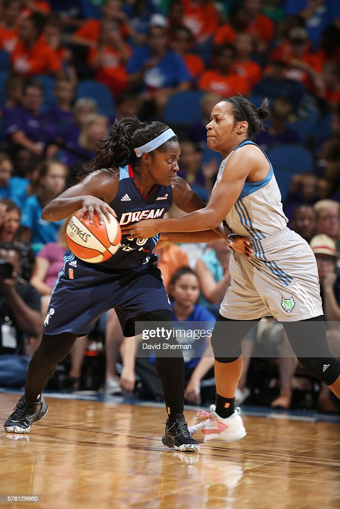 Matee Ajavon of the Atlanta Dream handles the ball against Jia Perkins of the Minnesota Lynx on July 20 2016 at Target Center in Minneapolis...