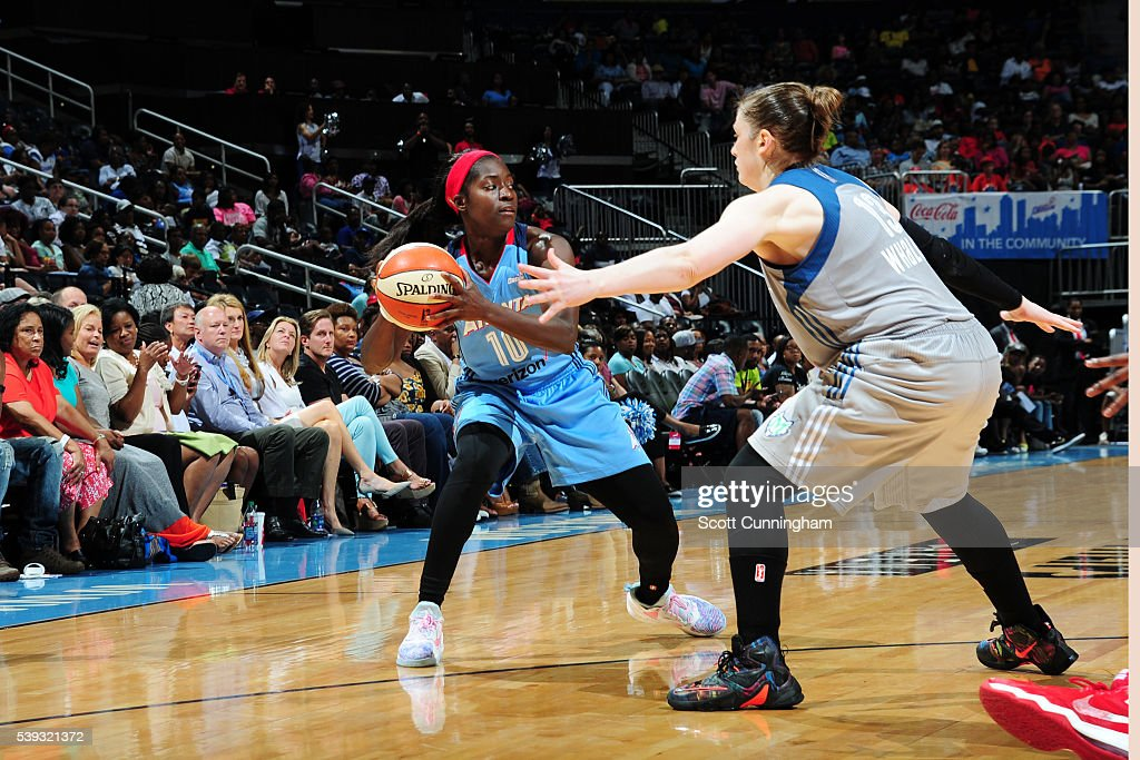 Matee Ajavon of the Atlanta Dream handles the ball against Lindsay Whalen of the Minnesota Lynx on June 10 2016 at Philips Arena in Atlanta Georgia...