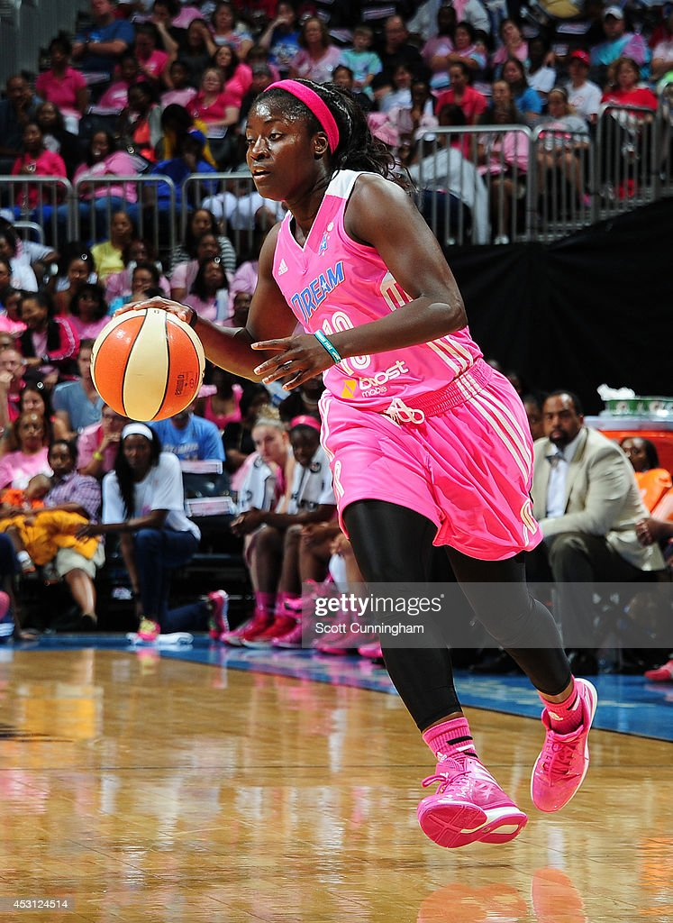 Matee Ajavon of the Atlanta Dream handles the ball against the New York Liberty on August 3 2014 at Philips Arena in Atlanta Georgia NOTE TO USER...