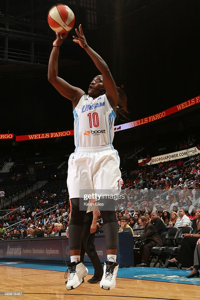<a gi-track='captionPersonalityLinkClicked' href=/galleries/search?phrase=Matee+Ajavon&family=editorial&specificpeople=2999736 ng-click='$event.stopPropagation()'>Matee Ajavon</a> #10 of the Atlanta Dream shoots the ball against the Indiana Fever during the 1st quarter of an WNBA game at Philips Arena on May 25 2014 in Atlanta, Georgia.