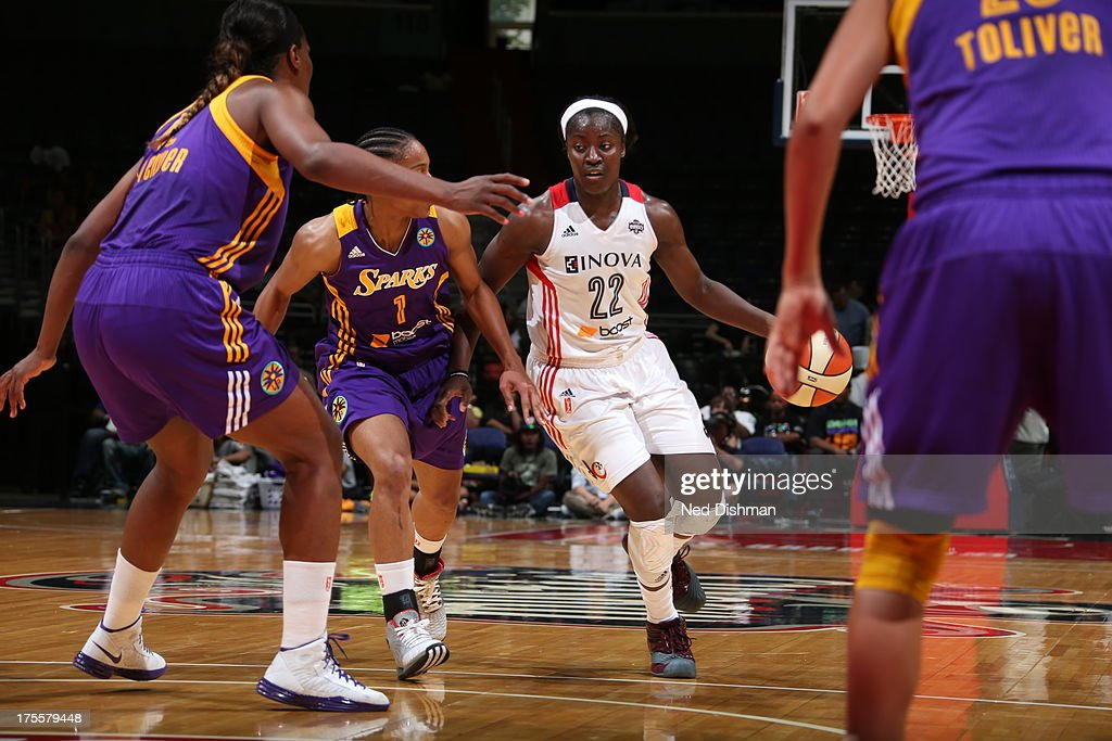 Matee Ajavon of the Washington Mystics drives against A'dia Mathies of the Los Angeles Sparks at the Verizon Center on August 4 2013 in Washington DC...