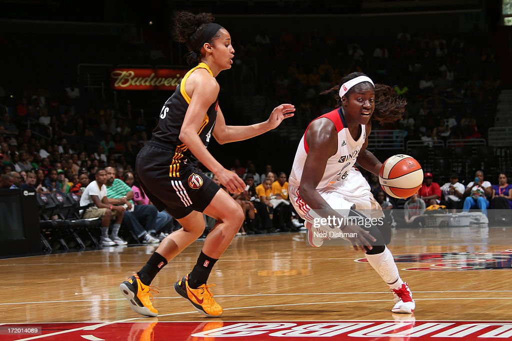 Matee Ajavon of the Washington Mystics drives against Skylar Diggins of the Tulsa Shock at the Verizon Center on June 30 2013 in Washington DC NOTE...