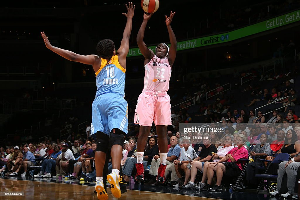 Matee Ajavon of the Washington Mystics shoots against Epiphanny Prince of the Chicago Sky at the Verizon Center on September 8 2013 in Washington DC...