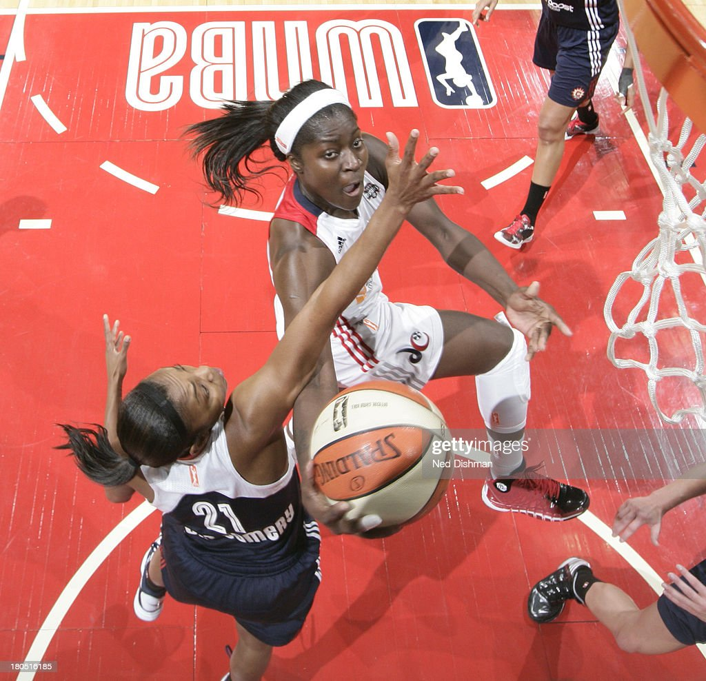 Matee Ajavon of the Washington Mystics shoots against Renee Montgomery of the Connecticut Sun at the Verizon Center on September 13 2013 in...