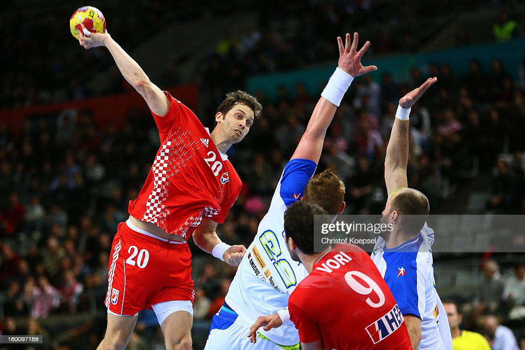 Matej Gaber and Vid Kavticnik of Slovenia defend against Damir Bicanic of Croatia during the Men's Handball World Championship 2013 third place match...