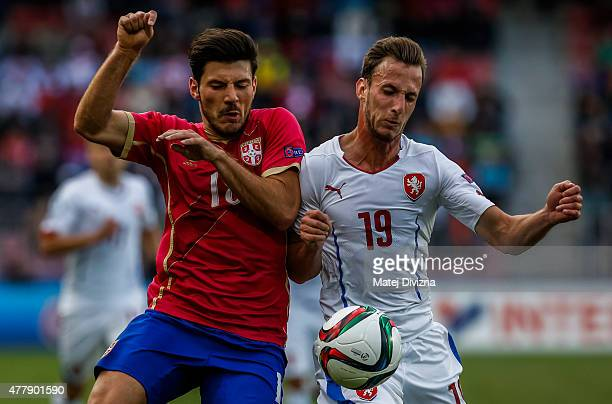 Matej Hybs of Czech Republic battles for the ball with Milos Jojic of Serbia during UEFA U21 European Championship Group A match between Serbia and...