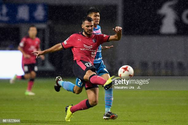 Matej Jonjic of Cerezo Osaka and Kyosuke Tagawa of Sagan Tosu compete for the ball during the JLeague J1 match between Sagan Tosu and Cerezo Osaka at...
