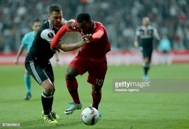 Matej Mitrovic of Besiktas in action against Alexandre Lacazette of Olympique Lyonnais during the UEFA Europa League quarter final second match...