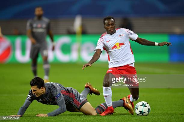 Matej Mitrovic of Besiktas is challenged by Bruma of RB Leipzig during the UEFA Champions League group G match between RB Leipzig and Besiktas at Red...