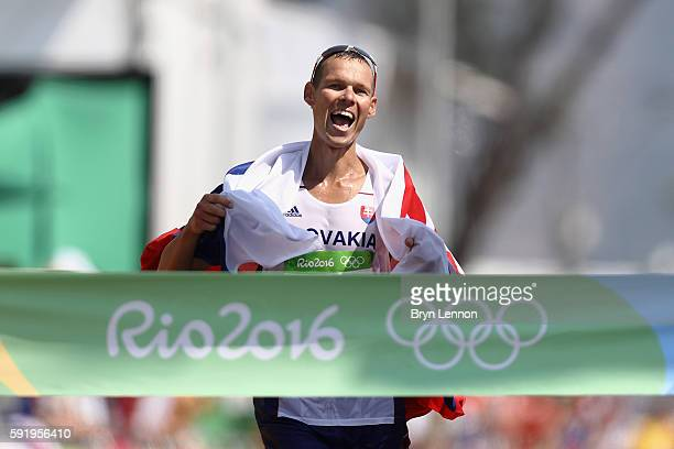 Matej Toth of Slovakia celebrates as he wins the gold medal in the Men's 50km Race Walk on Day 14 of the Rio 2016 Olympic Games at Pontal on August...