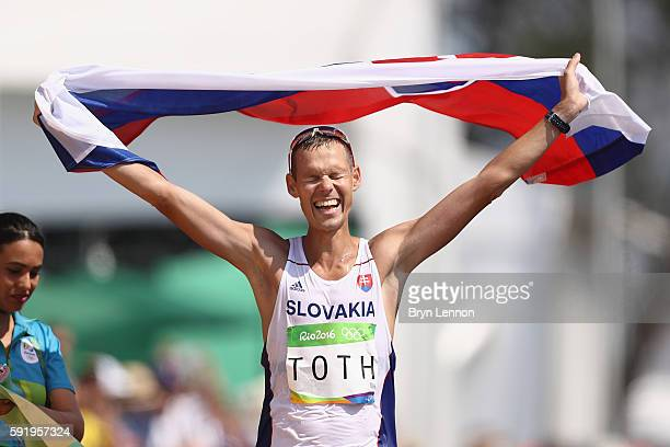 Matej Toth of Slovakia celebrates winning the gold medal in the Men's 50km Race Walk on Day 14 of the Rio 2016 Olympic Games at Pontal on August 19...