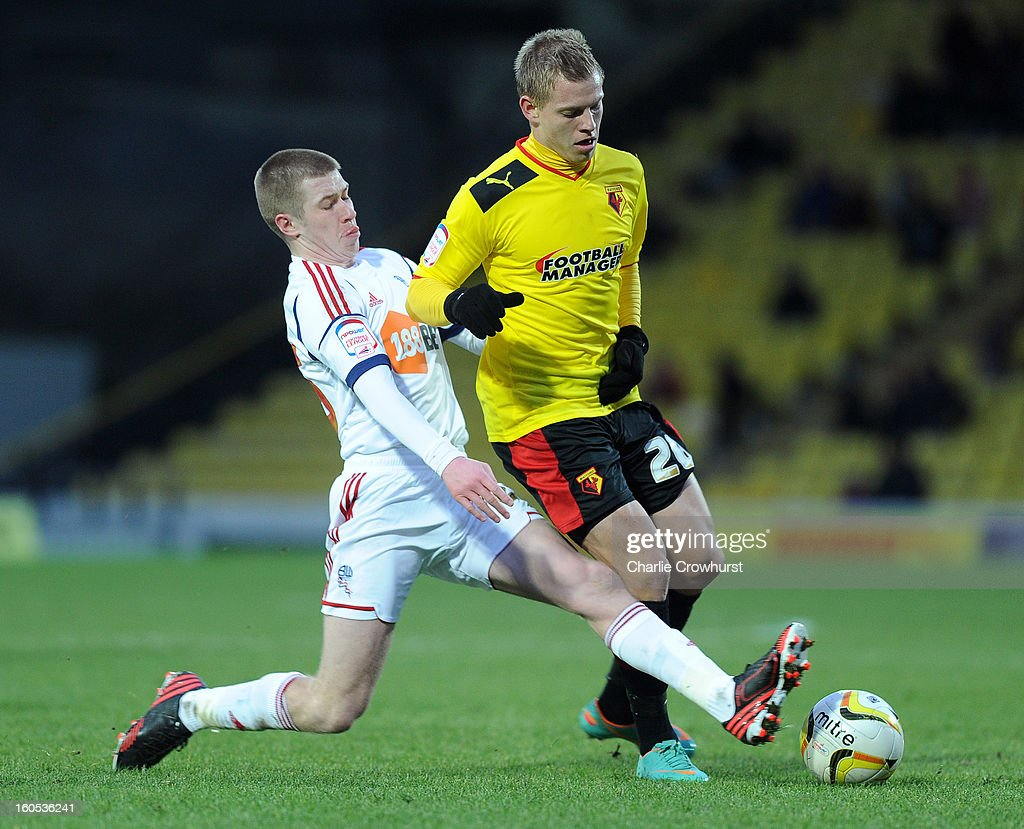 Matej Vydra of Watford is tackled by Bolton's Josh Vela during the npower Championship match between Watford and Bolton Wanderers at Vicarage Road on February 02, 2013 in Watford England.