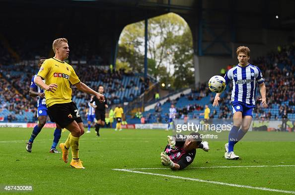 Matej Vydra of Watford scores the third goal past Keiren Westwood of Sheffield Wednesday during the Sky Bet Championship match between Sheffield...