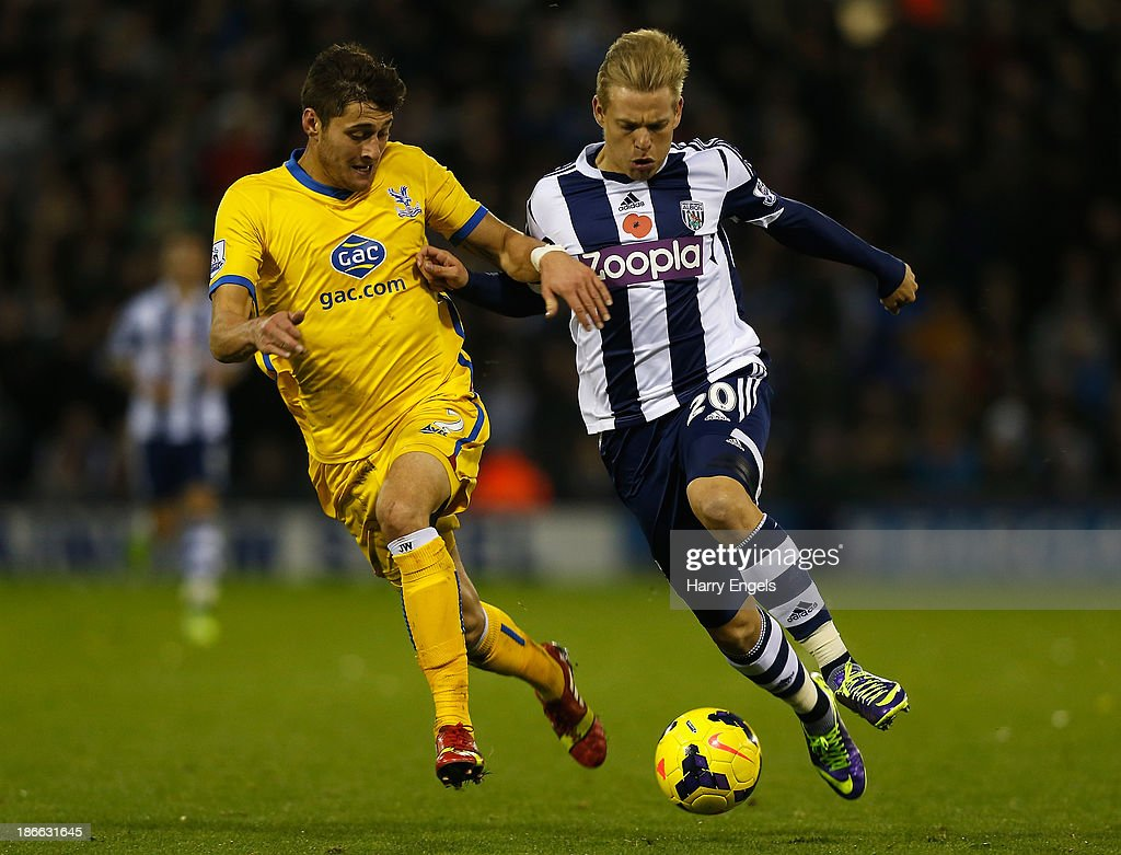 Matej Vydra of West Brom (R) and Joel Ward of Crystal Palace challenge for possession during the Barclays Premier League match between West Bromwich Albion and Crystal Palace at The Hawthorns on November 2, 2013 in West Bromwich, England.