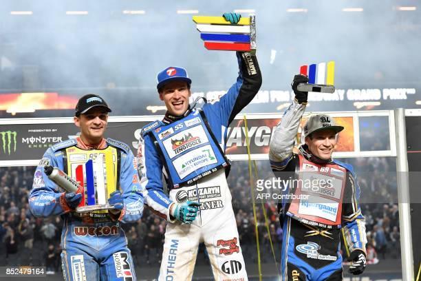 Matej Zagar of Slovenia celebrates his victory next to runner up Bartosz Zmarzlik of Poland and third placed Jason Doyle of Australia during the...