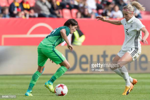 Mateja Zver of Slovenia and Kathrin Hendrich of Germany battle for the ball during the 2019 FIFA women's World Championship qualifier match between...