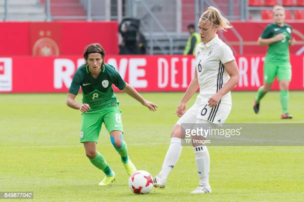 Mateja Zver of Slovenia and Kristin Demann of Germany battle for the ball during the 2019 FIFA women's World Championship qualifier match between...